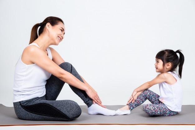 Young mother training lovely daughter with yoga 1150 14296